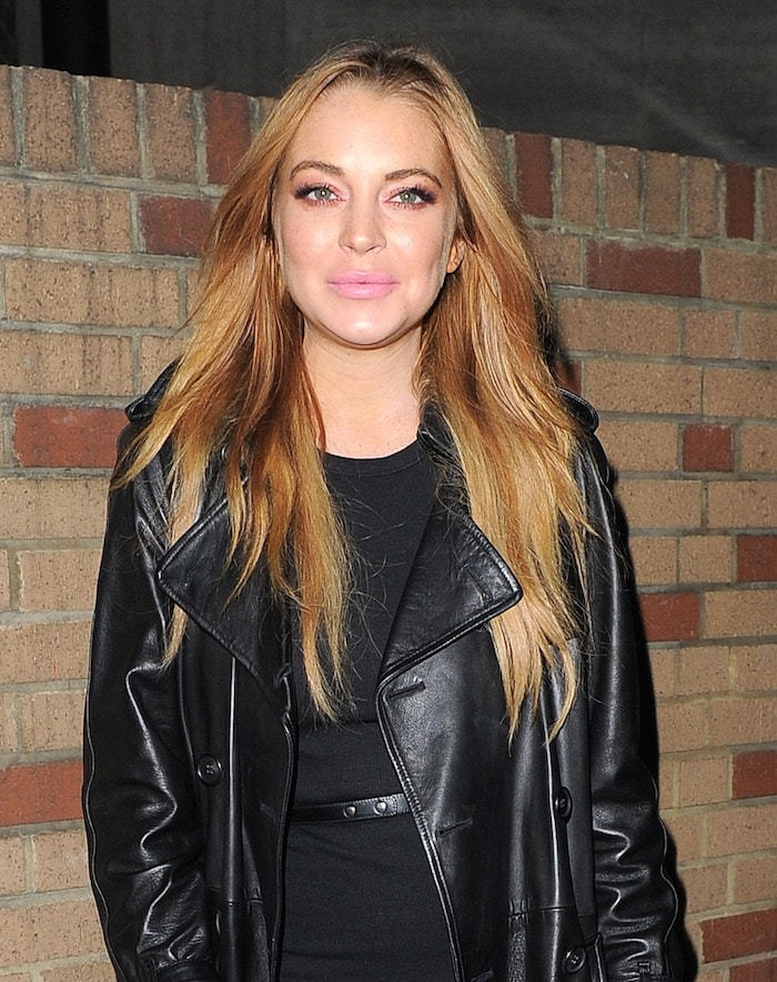 Lindsay Lohan with pink lips channeled her inner cat woman