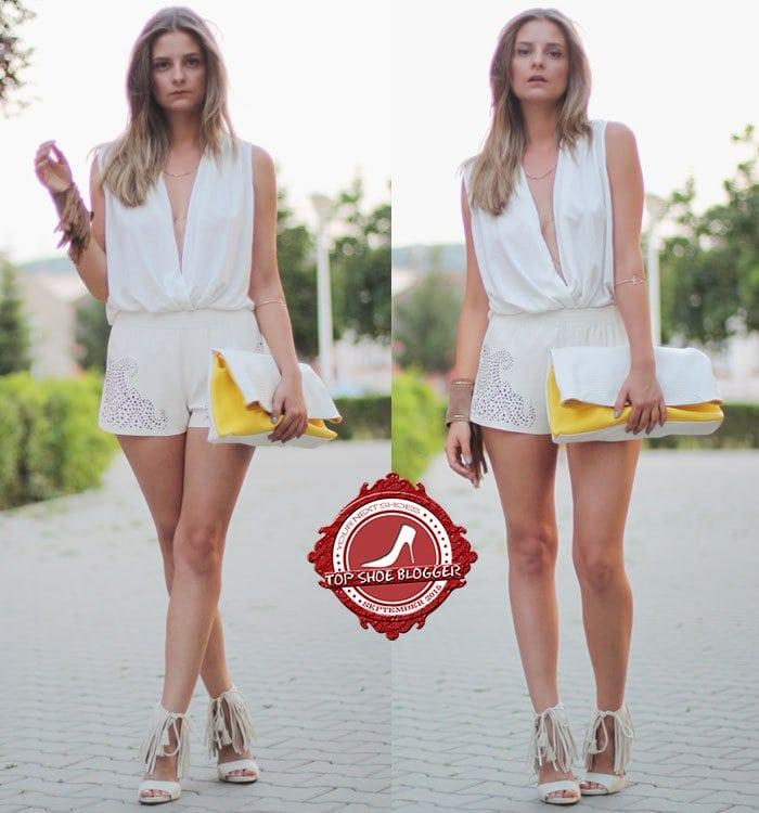 Madalina flaunts her legs in white fringe-cuff sandals