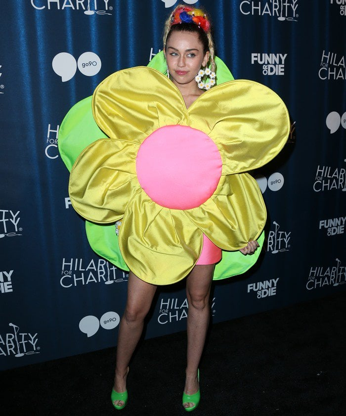 Miley Cyrus posed for the cameras in a flower mini dress from the Agatha Ruiz de la Prada Spring 2013 collection