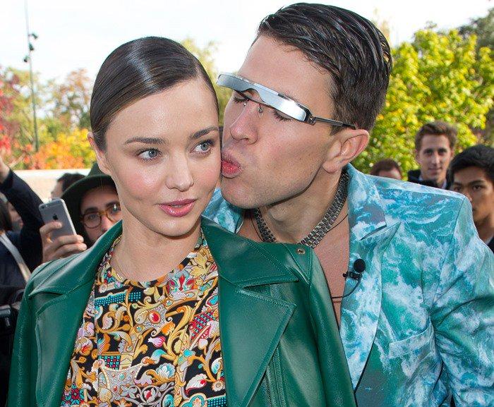 Vitalii Sediuk assaults Miranda Kerr with a kiss at the Louis Vuitton show held during Paris Fashion Week