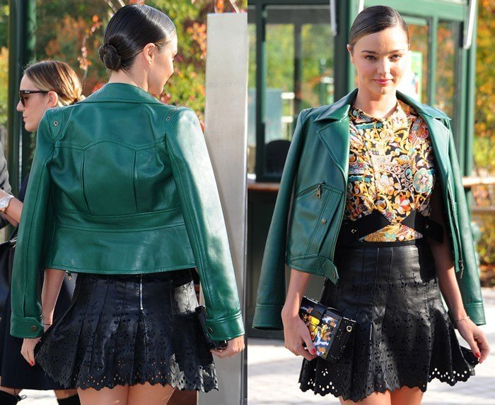 Miranda Kerr shows off her Louis Vuitton outfit as she attends Paris Fashion Week