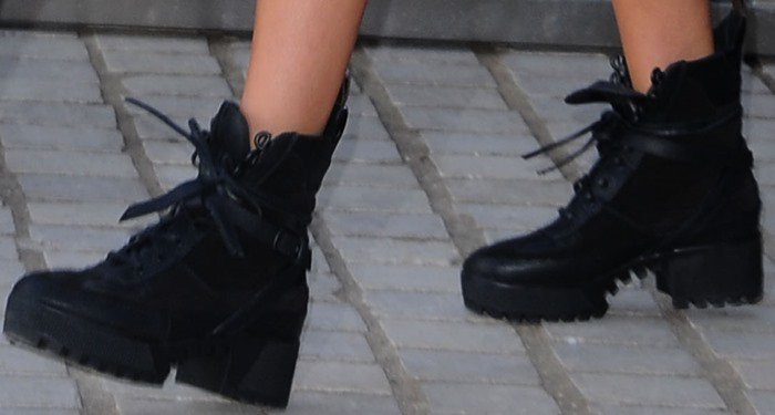 Miranda Kerr completes her outfit with a pair of Louis Vuitton boots
