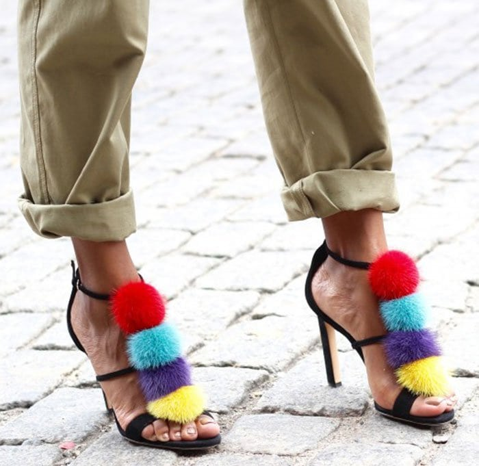 Monroe showed off her feet in colorful pompom sandals