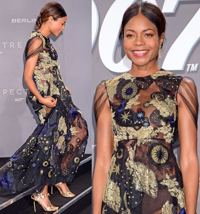 Naomie Harris shows off her strappy gold sandals as she hikes up her Valentino dress