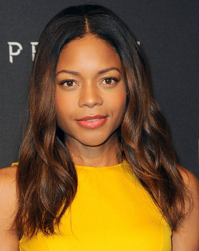Naomie Harris brightened up the black carpet in her demure pleated frock
