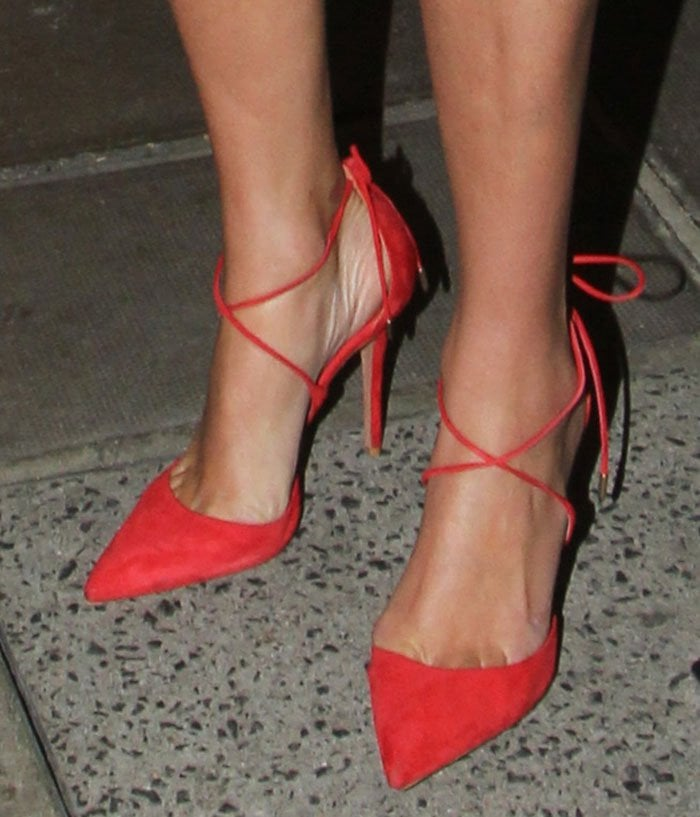 "Nicky Hilton's feet in red suede ""Matilde"" pumps"