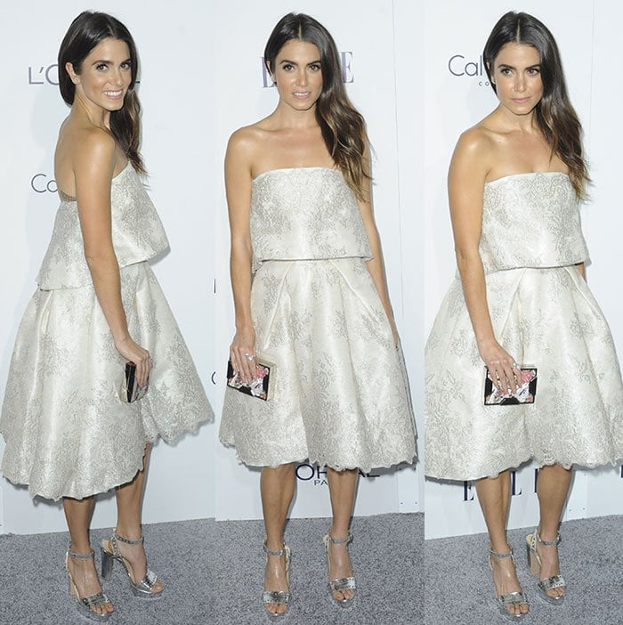 Nikki Reed carries a Lee Savage clutch on the carpet of the Elle Women in Hollywood Awards