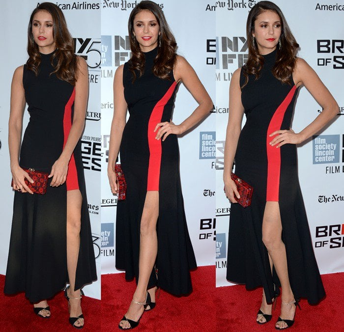 Nina Dobrev flaunts her sexy legs in a high neck dress from Versace