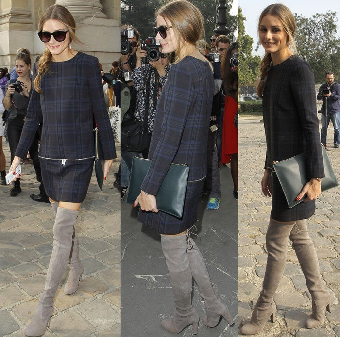 Olivia Palermo caps off her structured outfit with gray suede over-the-knee boots