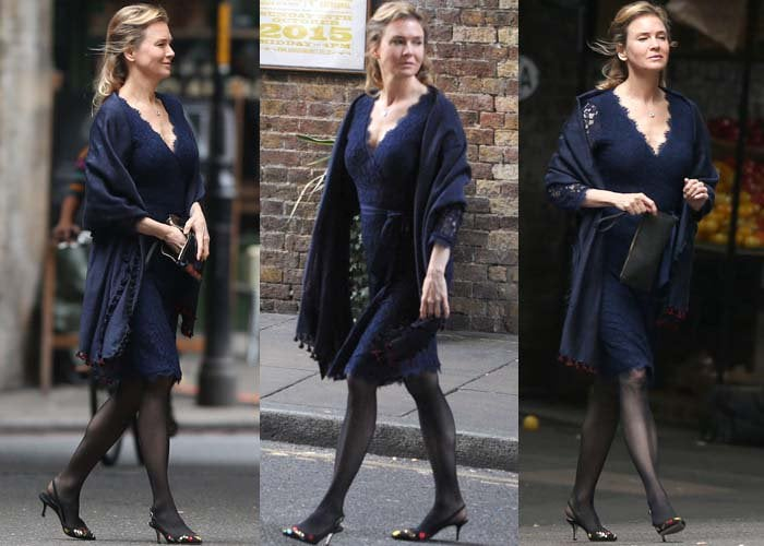 "Reneé Zellweger wears a blue lace dress and a shawl in London while filming for the latest ""Bridget Jones"" movie"
