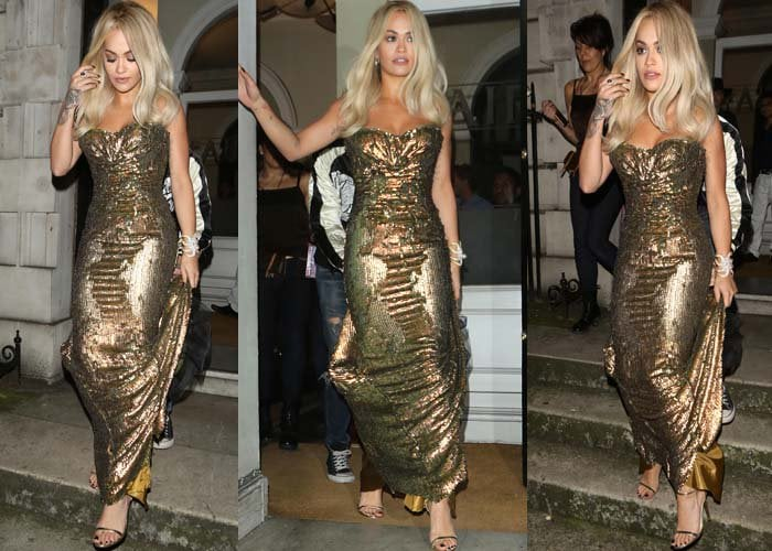 Rita Ora brushes her blonde hair out of her face as she arrives at a London restaurant