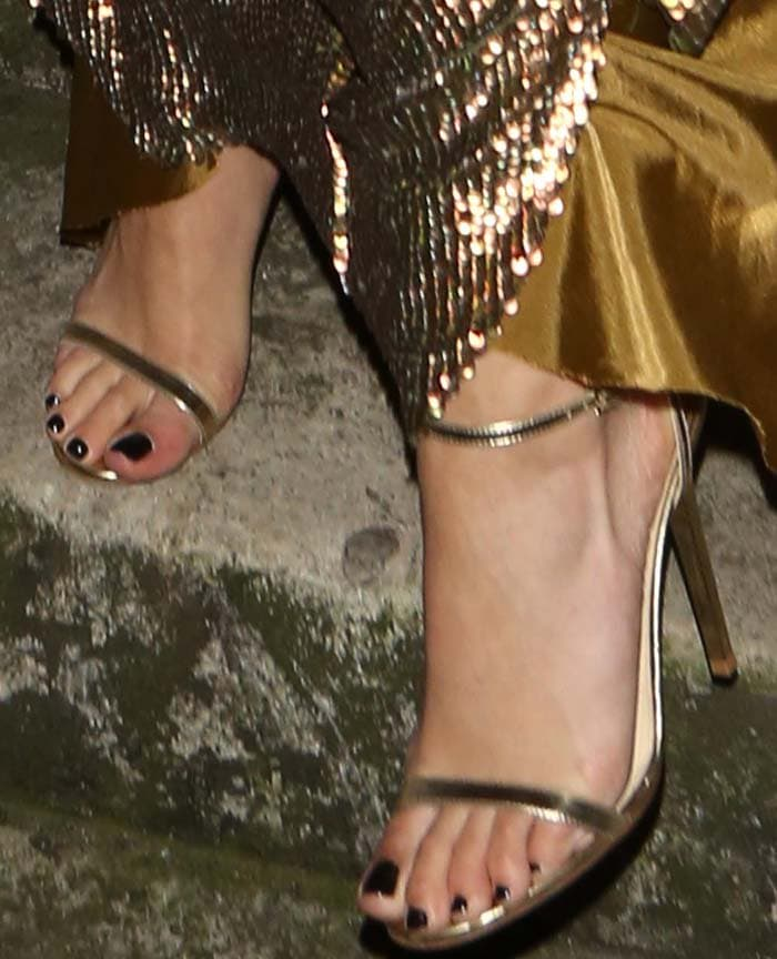 Rita Ora's sexy feet in strappy metallic sandals