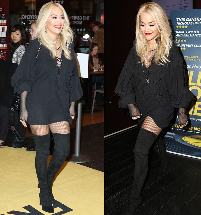 Rita Ora sported a fishnet body stocking underneath and accessorized with a pair of earrings, a sparkling diamond necklace by De Beers, and a few statement rings