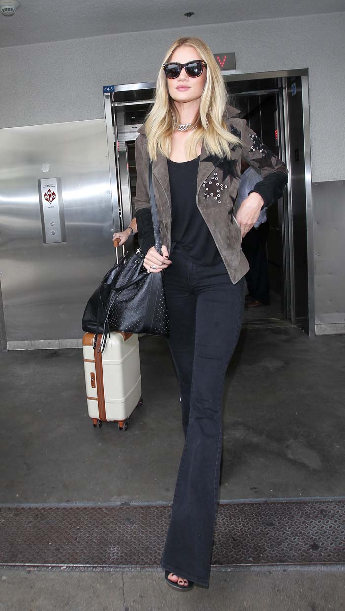 Rosie Huntington-Whiteley wears her blonde hair down as she makes airport travel look chic