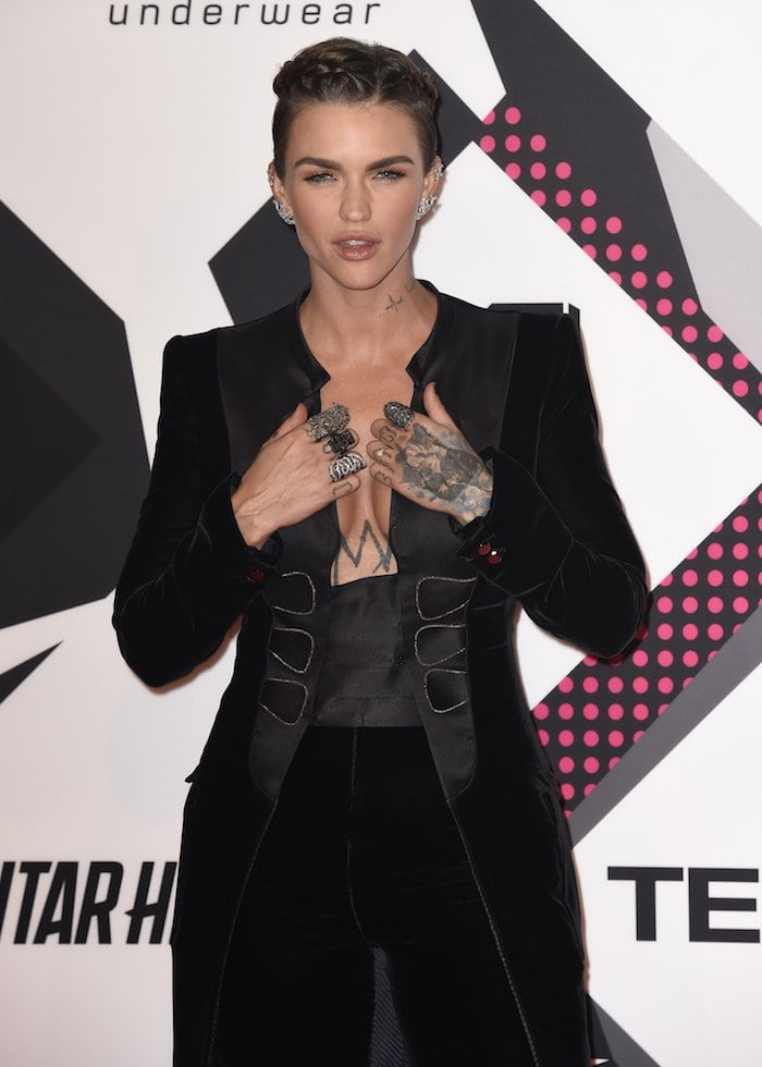 Ruby Rose shows off her cleavage in an Armani Prive suit on the red carpet of the 2015 MTV EMAs