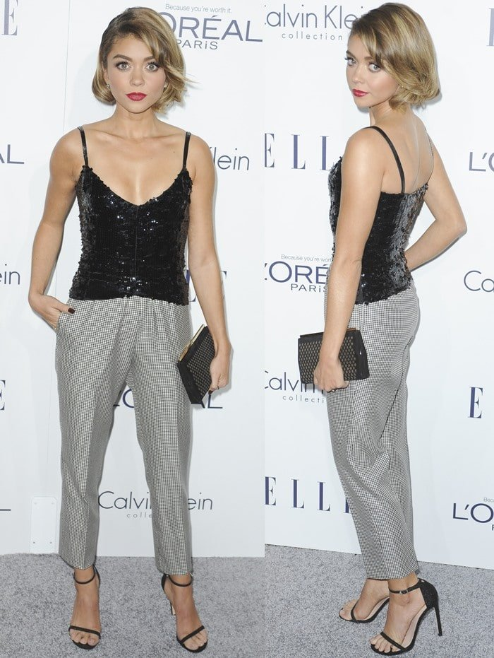 Sarah Hyland shows off her Armani tank top and trousers as she poses for photos