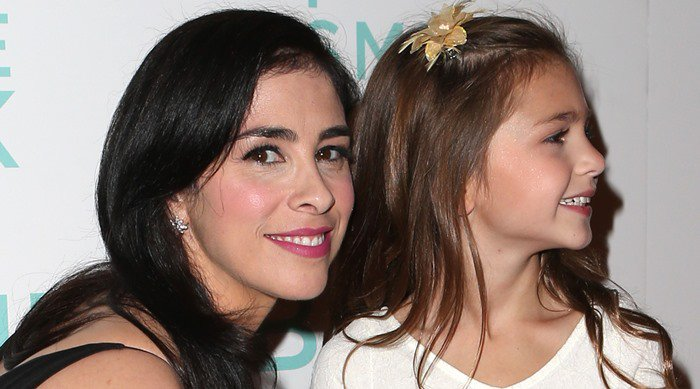 "Sarah Silverman and her ""I Smile Back"" co-star Shayne Coleman smile for photos on the red carpet"