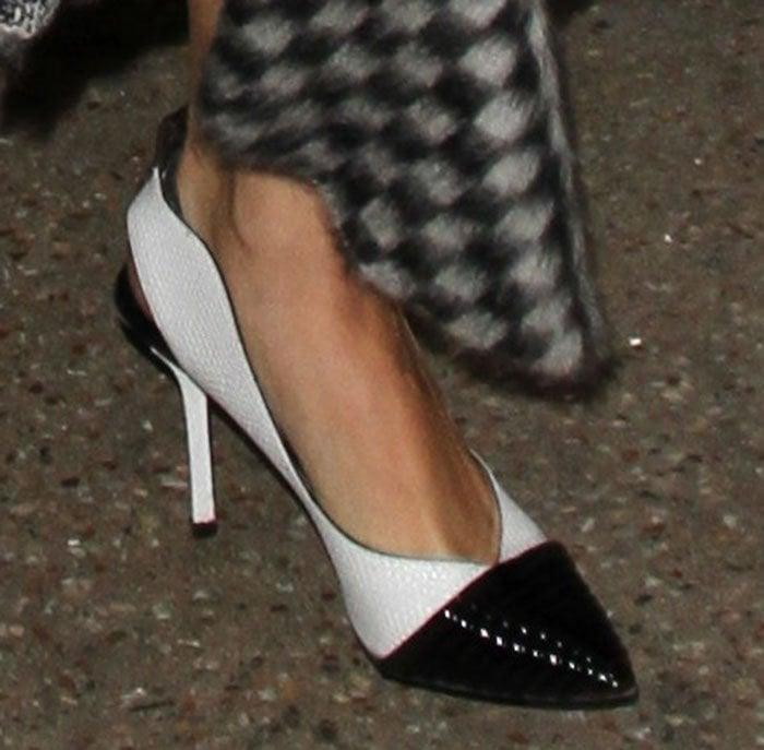 Selena Gomez strolls through LAX in a pair of Louis Vuitton slingback pumps