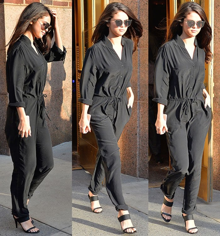 Selena Gomez fixes her hair as she leaves a New York City radio station in a black jumpsuit