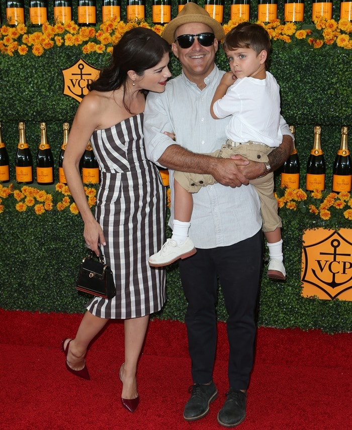 Selma Blair, posing with Jason Bleick and her son Arthur Bleick, at the 2015 Veuve Clicquot Polo Classic held at Will Rogers State Historic Park in Los Angeles on October 17, 2015