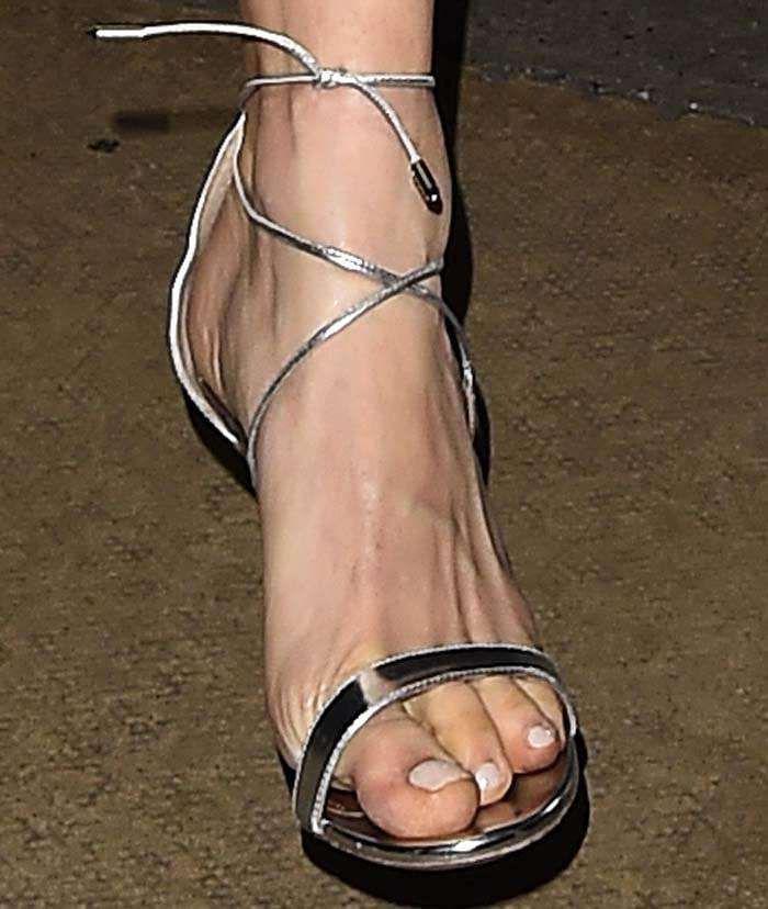Sienna Miller shows off her sexy feet in Aquazzura heels
