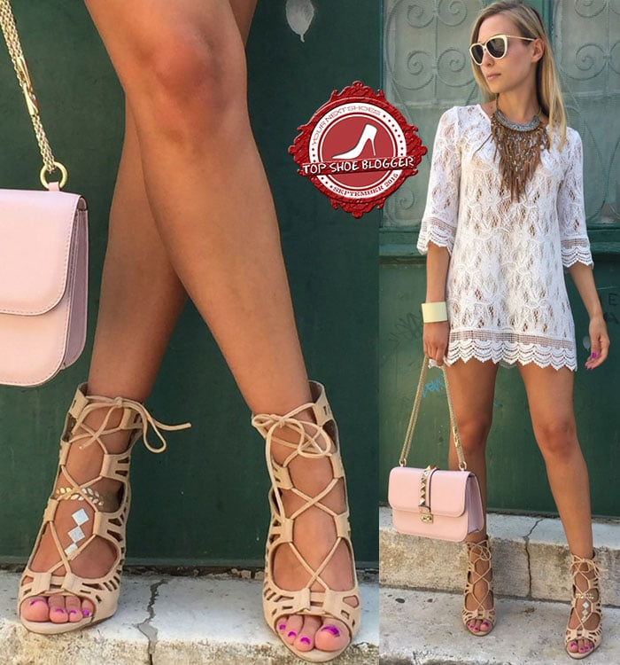 Sonja flaunts her legs in a white lace dress and lace-up sandals
