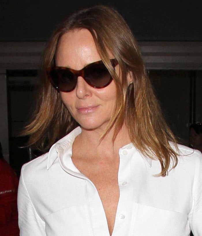 Stella McCartney, who has a net worth of $75 million, arrives at Los Angeles International Airport
