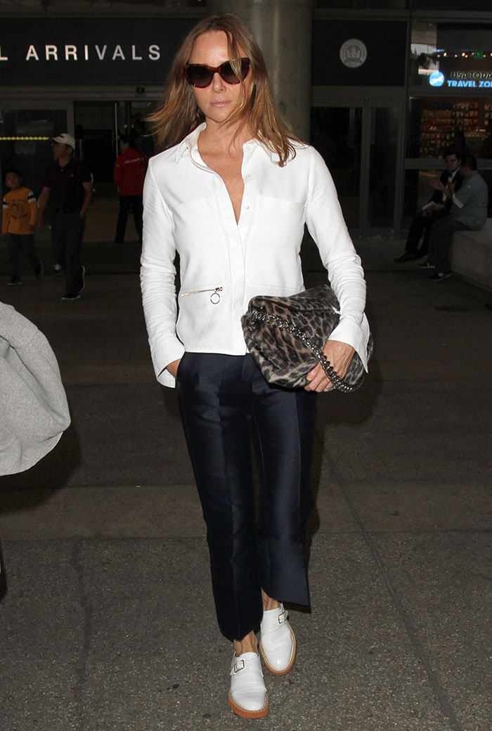 Stella McCartney arrives at LAX in a chic button-up paired with black trousers