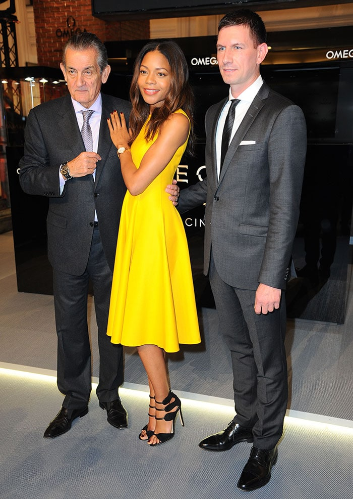 Stephen Urquhart, Noamie Harris, and Roland Armbruster at the OMEGA special exhibition at KaDeWe store in Berlin, Germany, on October 28, 2015