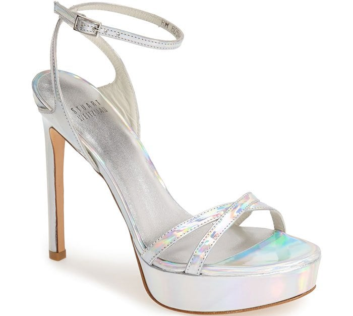 A prismatic silver finish adds futuristic flair to a scene-stealing platform sandal topped with a slim ankle strap