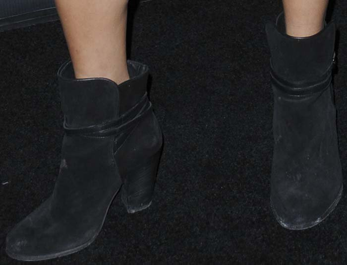 Vanessa Hudgens completes her black carpet look with a pair of AllSaints boots on her feet