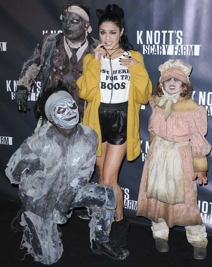 Vanessa Hudgens poses with a pair of cat ears on her hair at a haunted house event
