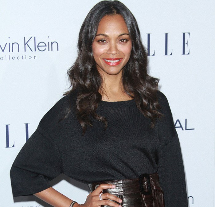 Zoe Saldana wears her dark hair long as she poses for photos