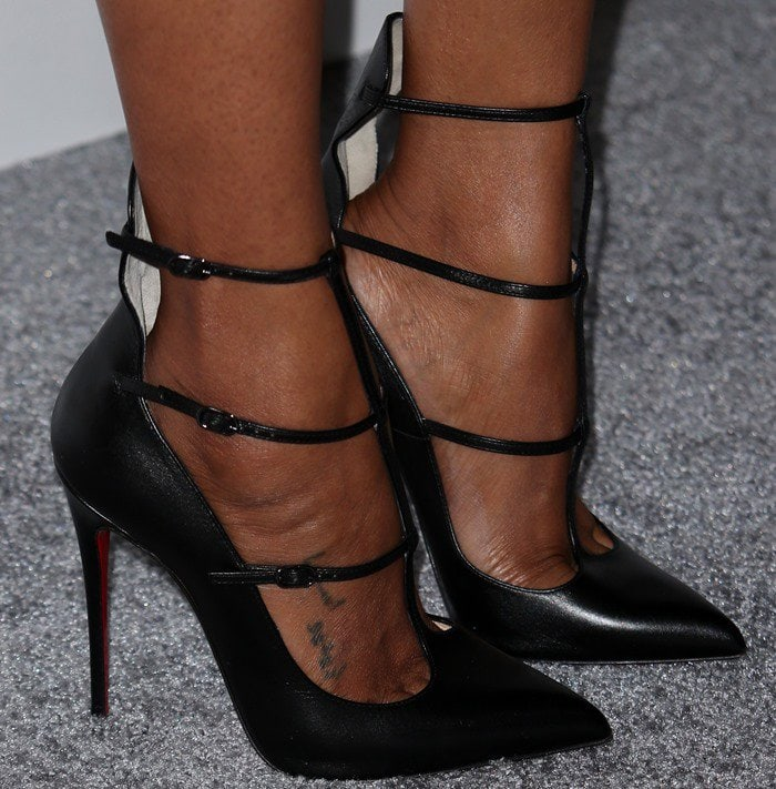 Zoe Saldana shows off the tattoos on her feet in a pair of strappy Christian Louboutin heels