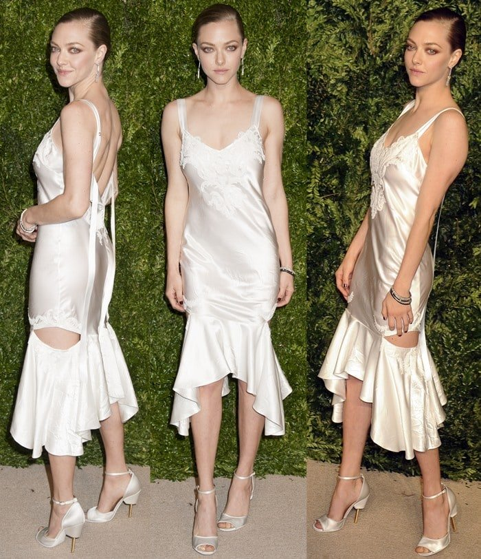 Amanda Seyfried poses for photos in a white Givenchy slip dress