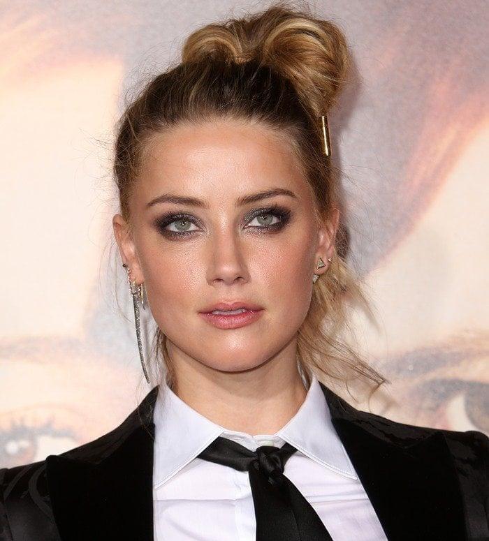 Amber Heard wore Melinda Maria's Phoenix pave stud earrings in her left ear