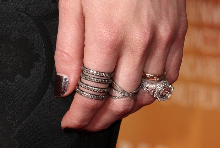 Amber Heard accessorized with a variety of rings