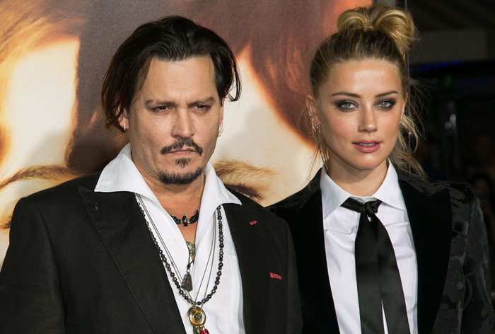Johnny Depp and Amber Heard looked like they had sex in the limo on their way to the premiere