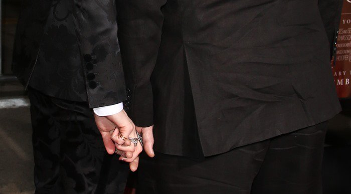 Amber Heard and her much older husband Johnny Depp holding hands