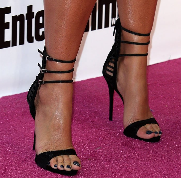 Amber's Giuseppe Zanotti sandals are made of sumptuous suede and glossy satin materials