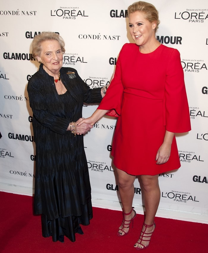 Madeline Albright and Amy Schumer pose on the red carpet of the Glamour Women of the Year Awards