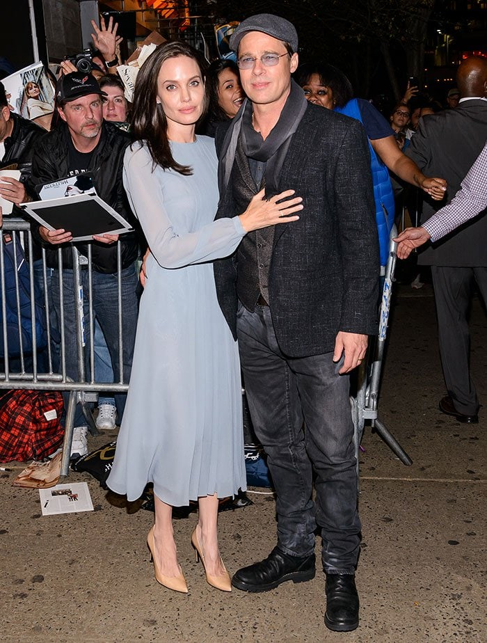 "Angelina Jolie poses for photos at the premiere of ""By the Sea"" with husband Brad Pitt"