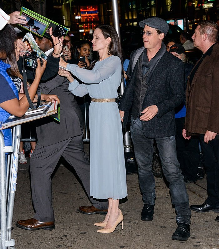 Angelina Jolie signs autographs in a chiffon blue dress from Luisa Beccaria