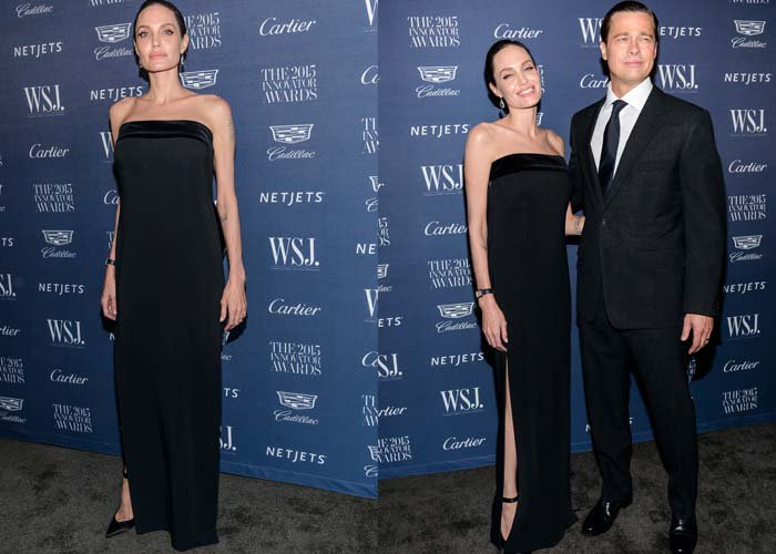 Angelina Jolie wears her hair back as she poses on the black carpet in a Tom Ford gown
