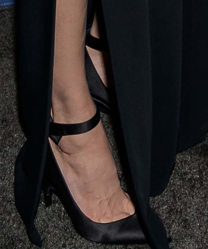 Angelina Jolie's feet in satin bow pumps