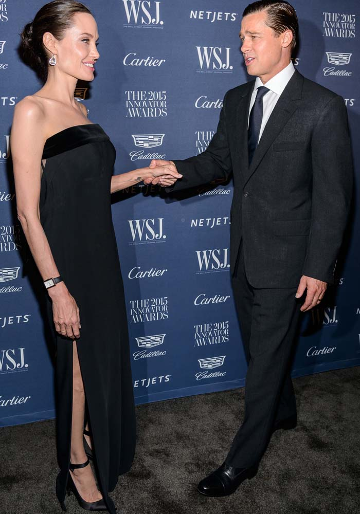 Brad Pitt grabs Angelina Jolie's hand on the black carpet
