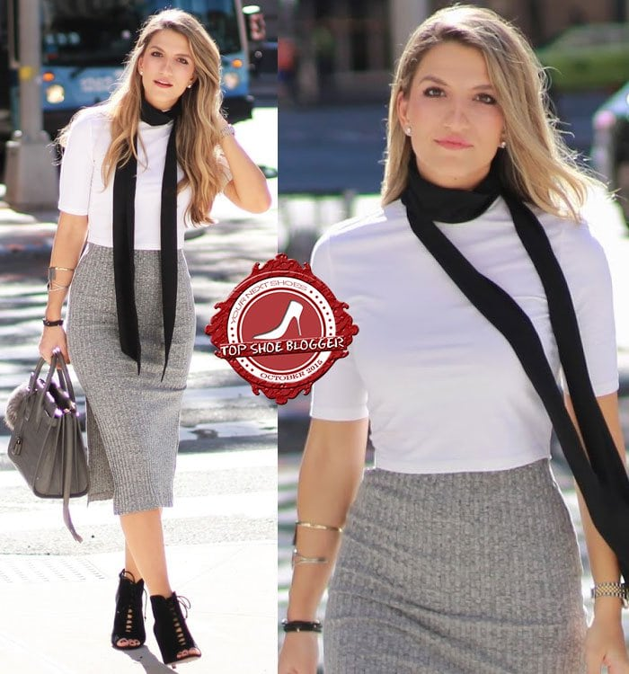 Cassandra styled a plain white top with a fitted gray knit skirt