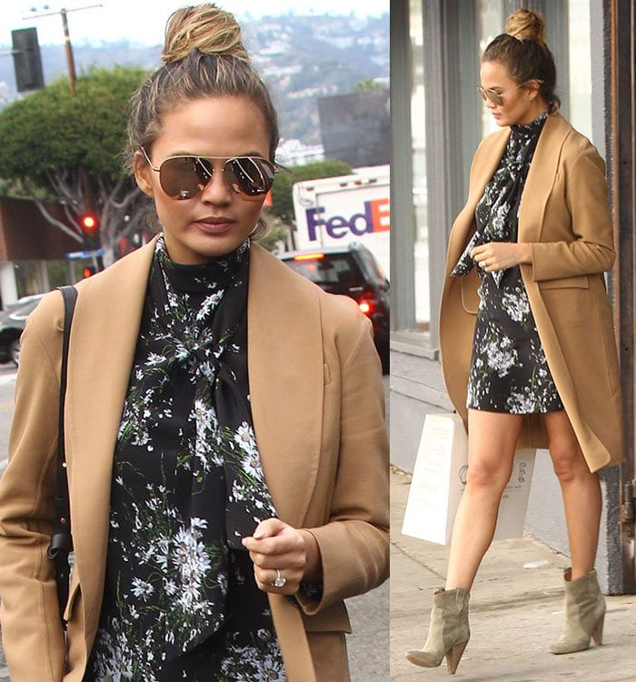 Chrissy Teigen wore her hair in a messy top knot