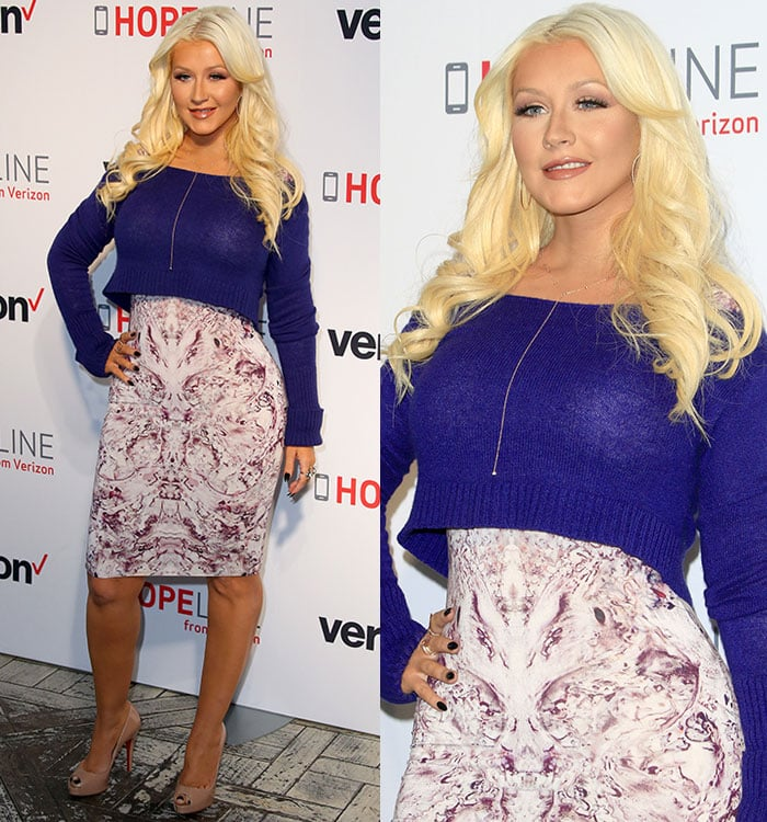 Christina Aguilera accessorized with gold jewelry, including a pair of Anita Ko hoop earrings, an EF Collection drop chain necklace, and a selection of rings by H. Stern, Anita Ko, and Graziela Gems