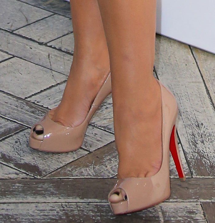 Christina Aguilera wearing Christian Louboutin Very Prive peep-toe pumps